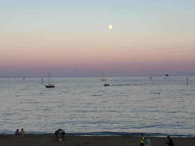 Sun sets over Barcelona beach